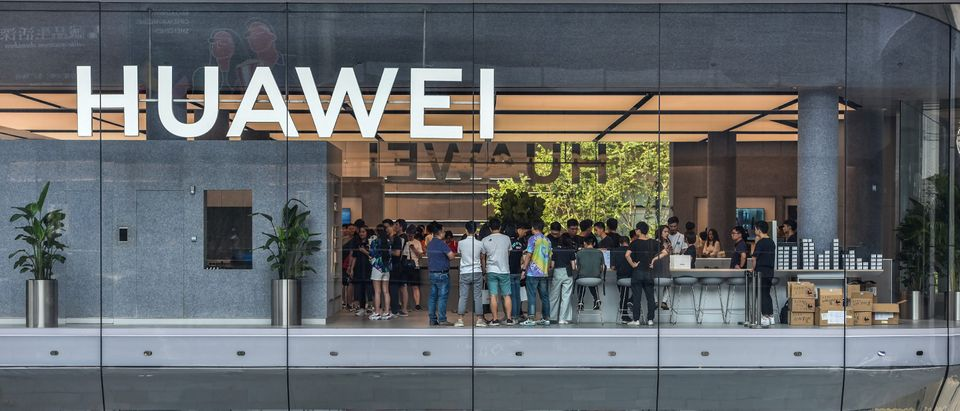 This photo taken on September 28, 2019 shows people visiting a newly-opened Huawei flagship store in Shenzhen in China's southern Guangdong province. (Photo by STR / AFP/ Getty Images)