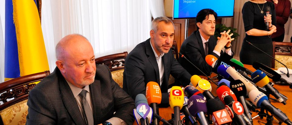 Ukraine's prosecutor-general Ruslan Ryaboshapka (2nd L) speaks to reporters during a press conference in Kiev on October 4, 2019. - Ukraine's prosecutor-general said on October 4, 2019, his office was reviewing the closure of a number of cases related to a gas firm linked to US Democrat Joe Biden's son. Prosecutor-General Ryaboshapka told reporters there were about 15 cases but stressed that they were not necessarily connected to Biden's son, Hunter Biden. (Photo by Sergei CHUZAVKOV / AFP) (Photo by SERGEI CHUZAVKOV/AFP via Getty Images)
