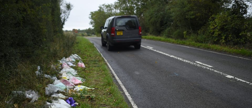 A general view of flowers left in remembrance of Harry Dunn on the B4031 near RAF Croughton on Oct. 7, 2019 near Brackley, England. (Peter Summers/Getty Images)