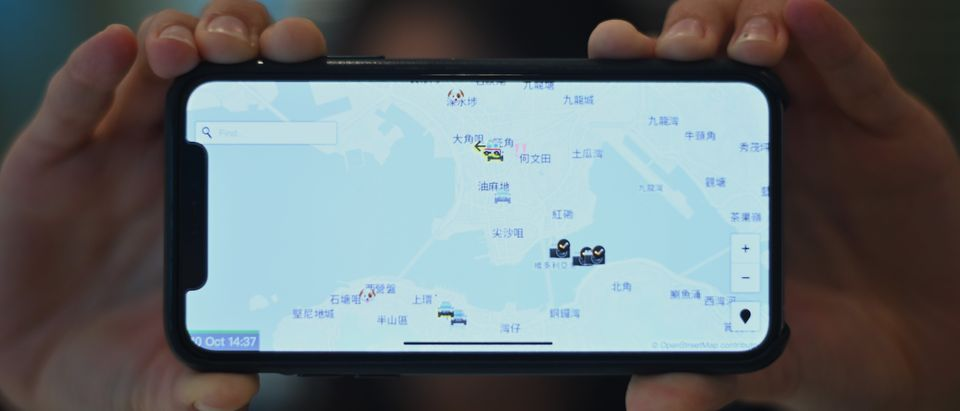 "This photo illustration shows a smartphone displaying the ""HKmap.live"" app in Hong Kong on October 10, 2019. - Apple on October 10 removed an app criticised by China for allowing protesters in Hong Kong to track police, as Beijing steps up pressure on foreign companies deemed to be providing support to the pro-democracy movement. (Photo by Philip FONG / AFP) (Photo by PHILIP FONG/AFP via Getty Images)"