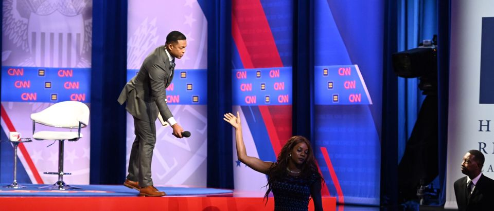 A transgender woman audience member gives the microphone back to moderator Don Lemon during a town hall devoted to LGBTQ issues hosted by CNN and the Human rights Campaign Foundation at The Novo in Los Angeles on Oct. 10, 2019. (ROBYN BECK/AFP via Getty Images)