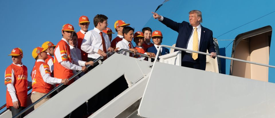 US President Donald Trump boards Air Force One with members of the Little League World Championship baseball team, the Eastbank All Stars of Louisiana.