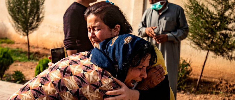 Women react as the body of a man killed during Turkish shelling in the area surrounding the Syrian Kurdish town of Ras al-Ain arrives at a hospital in the nearby town of Tal Tamr following the announced ceasefire on October 18, 2019.(Photo by DELIL SOULEIMAN/AFP via Getty Images)