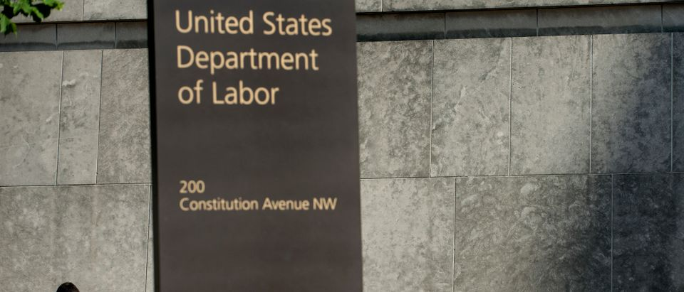 A man walks by the U.S. Department of Labor building on May 3, 2013 in Washington, D.C. (BRENDAN SMIALOWSKI/AFP/Getty Images)