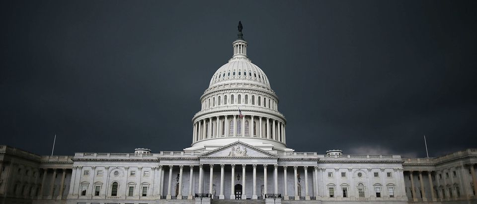 Storm clouds fill the sky over the U.S. Capitol Building, June 13, 2013 in Washington, D.C. (Photo by Mark Wilson/Getty Images)