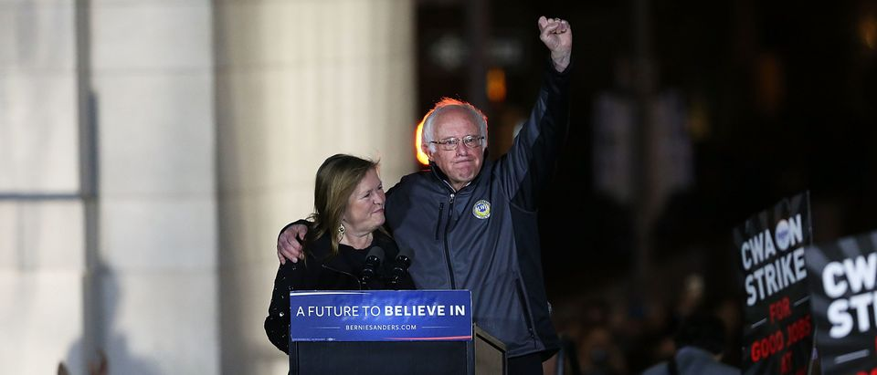 NEW YORK, NEW YORK - APRIL 13: Democratic Presidential candidate Bernie Sanders stands on stage with his wife Jane O'Meara Sanders before speaking to thousands of people at a rally for in New York CityÕs historic Washington Square Park on April 13, 2016 in New York City. While Sanders is still significantly behind Hillary Clinton in the delegate count, he continues to run a spirited campaign that has resonated with young and liberal voters. (Photo by Spencer Platt/Getty Images)