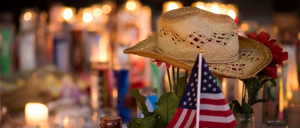 A hat is left at a makeshift memorial during a vigil to mark one week since the mass shooting at the Route 91 Harvest country music festival, on the corner of Sahara Avenue and Las Vegas Boulevard at the north end of the Las Vegas Strip, on Oct. 8, 2017 in Las Vegas, Nevada. (Photo by Drew Angerer/Getty Images)