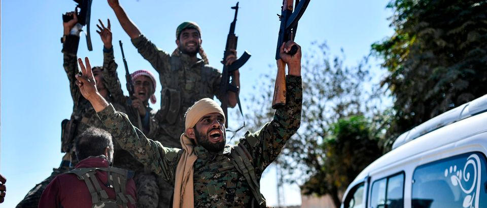 Members of the Syrian Democratic Forces (SDF), backed by U.S. special forces, celebrate at the frontline in the Islamic State (IS) group jihadis crumbling stronghold of Raqa on Oct. 16, 2017. (BULENT KILIC/AFP/Getty Images)