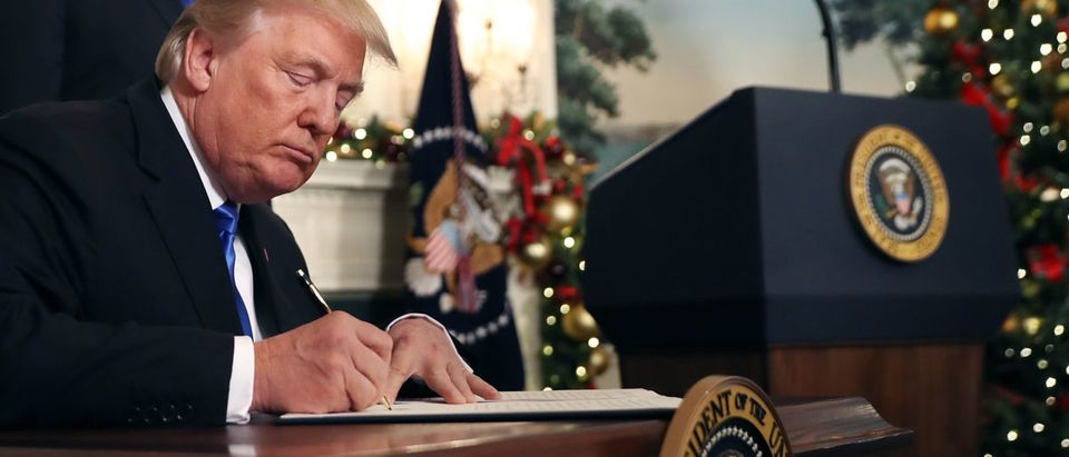 U.S. President Donald Trump signs a proclamation that the U.S. government will formally recognize Jerusalem as the capital of Israel after signing the document in the Diplomatic Reception Room at the White House Dec. 6, 2017 in Washington, D.C. (Photo by Chip Somodevilla/Getty Images)