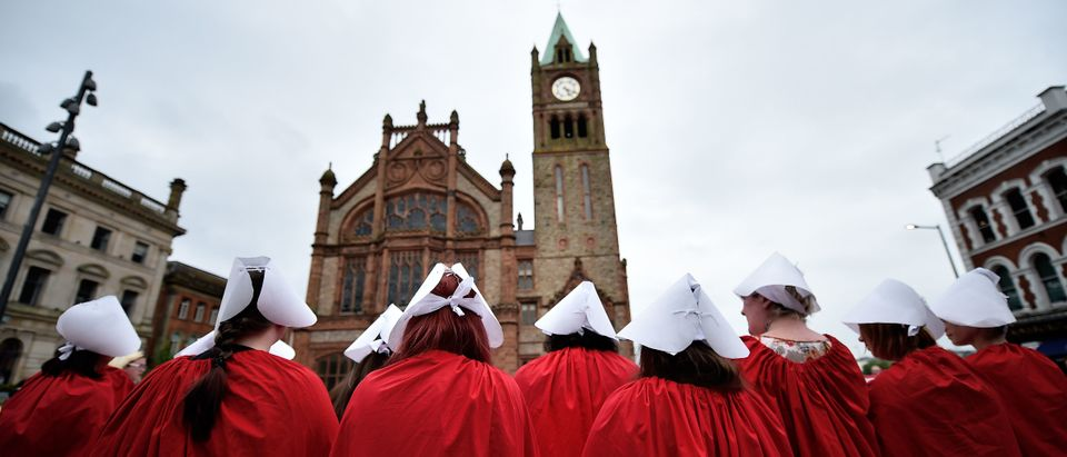 LONDONDERRY, NORTHERN IRELAND - MAY 31: Pro Choice supporters wear handmaiden robes as the abortion rights campaign group ROSA, Reproductive Rights Against Oppression, Sexism and Austerity holds a rally at Guildhall square on May 31, 2018 in Londonderry, Northern Ireland. The group had earlier risked arrest after distributing abortion pills from a touring bus. Flouting Northern Irish governmental laws which forbid the use of abortion pills the group also protested outside offices belonging to the main political parties in the province. Women in Northern Ireland have been prosecuted for buying abortion pills over the internet and it is illegal for a woman to have an abortion unless in special circumstances unlike the rest of the United Kingdom. The Republic of Ireland voted in favour of pro-choice last week in a referendum. (Photo by Charles McQuillan/Getty Images)