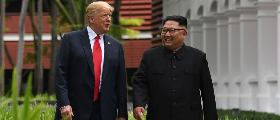 North Korea's leader Kim Jong Un (R) walks with US President Donald Trump (L) during a break in talks at their historic US-North Korea summit, at the Capella Hotel on Sentosa island in Singapore on June 12, 2018. - Donald Trump and Kim Jong Un became on June 12 the first sitting US and North Korean leaders to meet, shake hands and negotiate to end a decades-old nuclear stand-off. (Photo by SAUL LOEB / AFP)