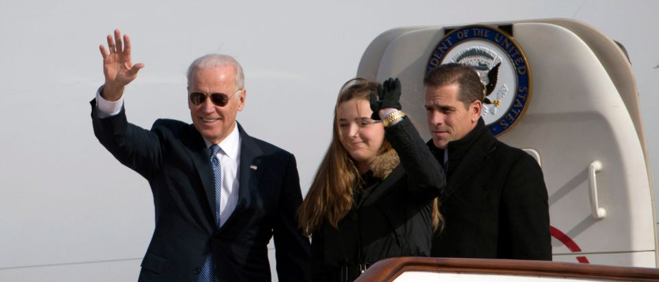 U.S. Vice President Joe Biden waves as he walks out of Air Force Two with his granddaughter Finnegan Biden and son Hunter Biden (R) on Dec. 4, 2013 in Beijing, China. (Photo by Ng Han Guan-Pool/Getty Images)