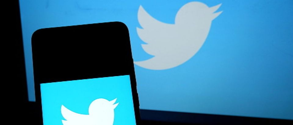 In this photo illustration a popular micro blogging and social networking service Twitter logo seen displayed on a smartphone.