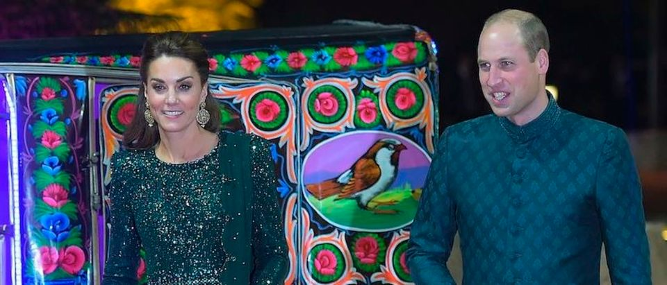 Britain's Prince William (R), Duke of Cambridge, and his wife Catherine, Duchess of Cambridge, arrive on a decorated auto-rickshaw to attend a reception in Islamabad on October 15, 2019. - Pakistani Prime Minister Imran Khan gave a warm welcome in Islamabad on October 15 to Britain's Prince William, the son of his late friend Princess Diana, who is on his first official trip to the country with his wife Kate. (Photo by Aamir QURESHI / AFP) (Photo by AAMIR QURESHI/AFP via Getty Images)