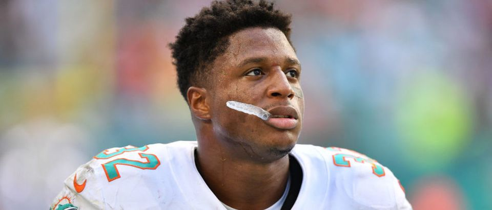 MIAMI, FLORIDA - OCTOBER 13 Kenyan Drake #32 of the Miami Dolphins looks on from the sidelines after dropping the two point conversion against the Washington Redskins in the fourth quarter at Hard Rock Stadium on October 13, 2019 in Miami, Florida. (Photo by Mark Brown/Getty Images)