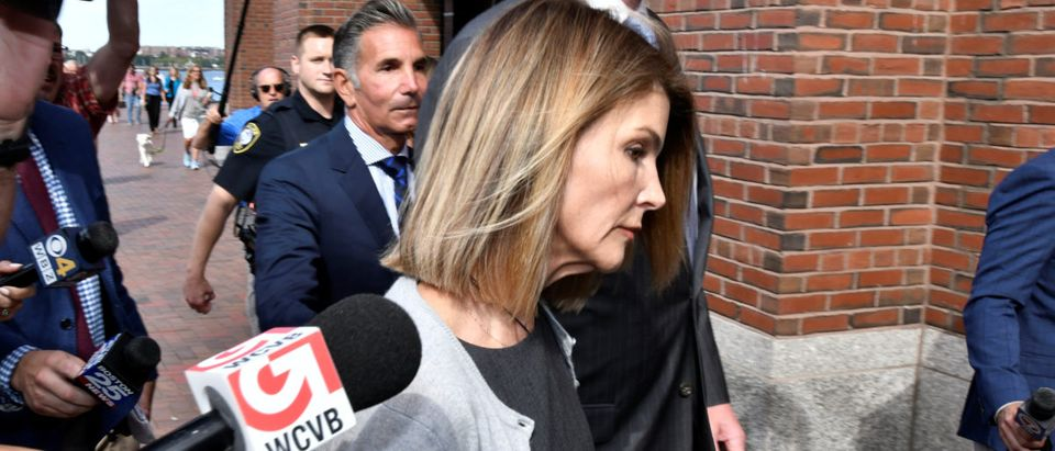 Actress Lori Loughlin, and her husband, fashion designer Mossimo Giannulli leave the federal courthouse after a hearing on charges in a nationwide college admissions cheating scheme in Boston