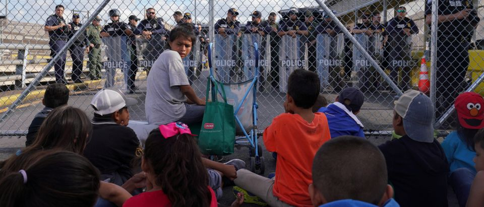 A group of migrants who returned to Mexico to await their U.S. asylum hearing block the Puerta Mexico international border crossing bridge