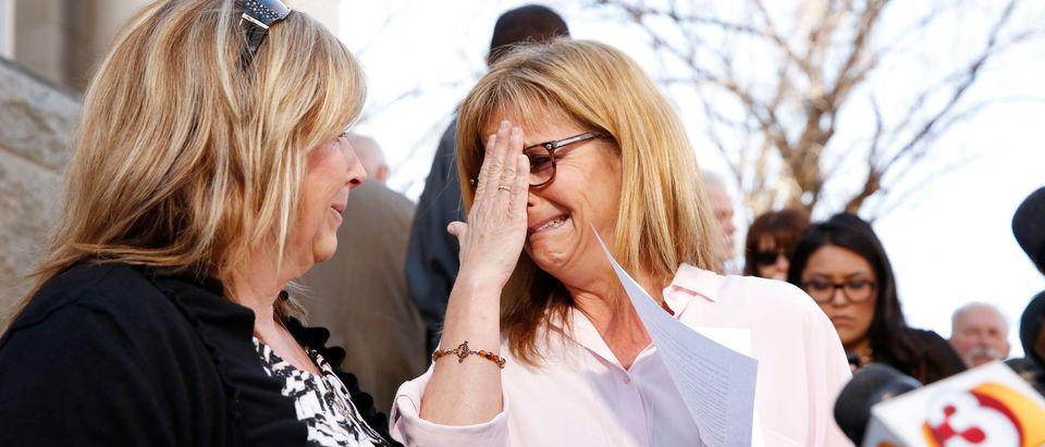 The aunts of Kayla Mueller react after giving a statement at a news conference in Prescott