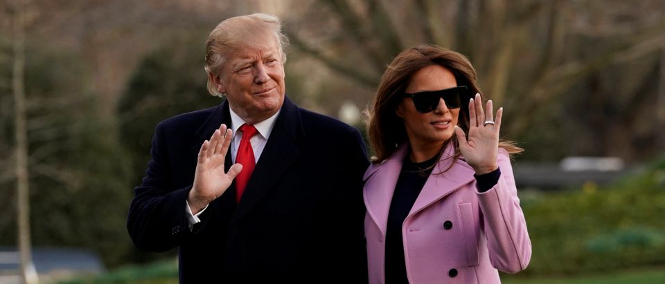 U.S. President Donald Trump and First Lady Melania Trump wave on the South Lawn of the White House upon their return to Washington from West Palm Beach, Florida. REUTERS/Yuri Gripas TPX IMAGES OF THE DAY