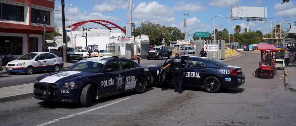 Mexican Federal Police block the entrance to the Puerta Mexico international border crossing because a group of migrants occupied the international bridge