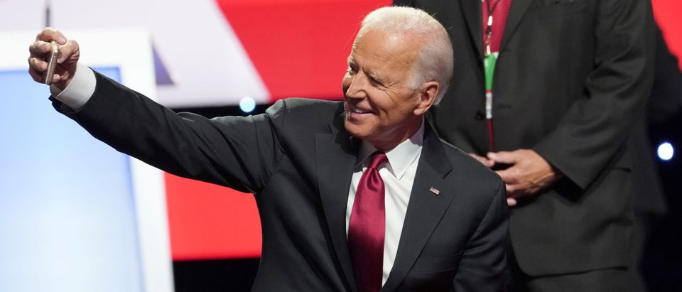 Democratic presidential candidate and former Vice President Joe Biden shoots a selfie with the crowd at the conclusion of the fourth U.S. Democratic presidential candidates 2020 election debate in Westerville, Ohio