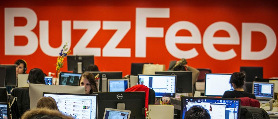 BuzzFeed employees work at the company's headquarters in New York, Jan. 9, 2014. REUTERS/Brendan McDermid/File Photo