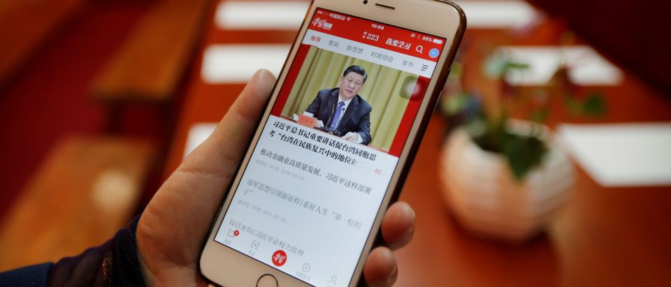 Cheng Hong, Tidal Star Group's communist party secretary, displays an app Xuexi Qiangguo in Beijing