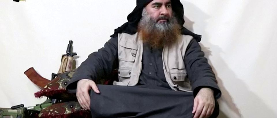 Bearded man with IS leader al-Baghdadi's appearance speaks in this screen grab taken from video
