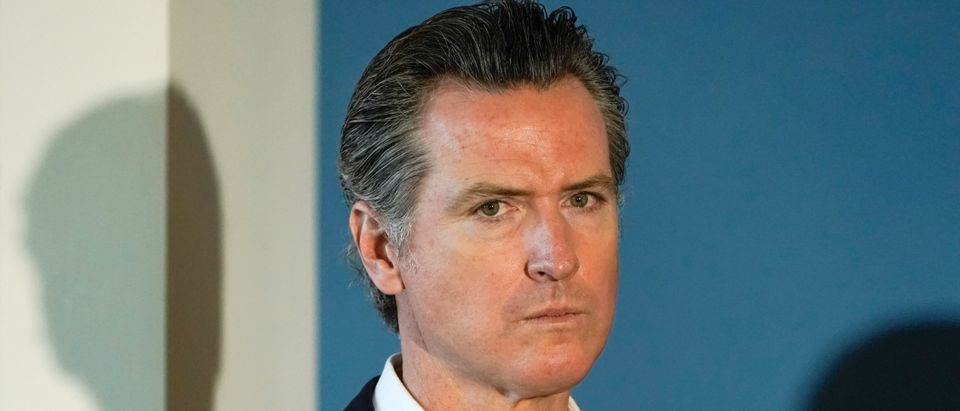 California governor Gavin Newsom waits to speak at a news conference in San Diego