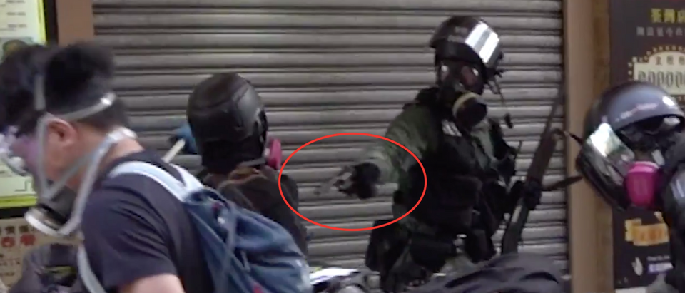 Police officer shoots Hong Kong protester/ Twitter video