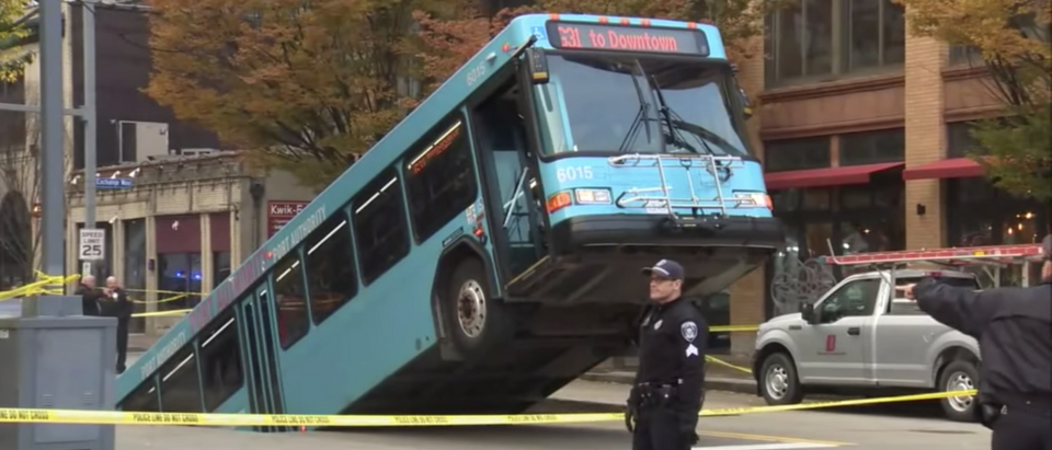 The front of a city bus is up in the air after a sinkhole opened under it during rush hour in downtown Pittsburgh.