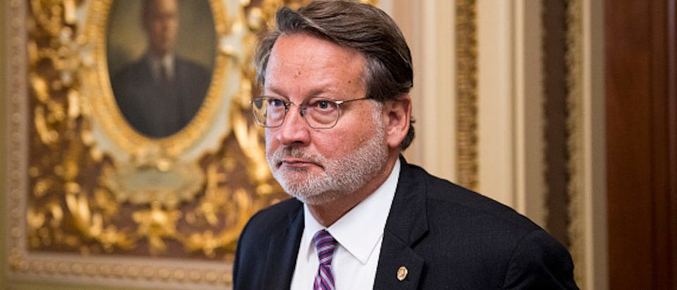Sen. Gary Peters, D-Mich., leaves the Senate Democrats policy lunch in the Capitol on Tuesday, Sept. 10, 2019.
