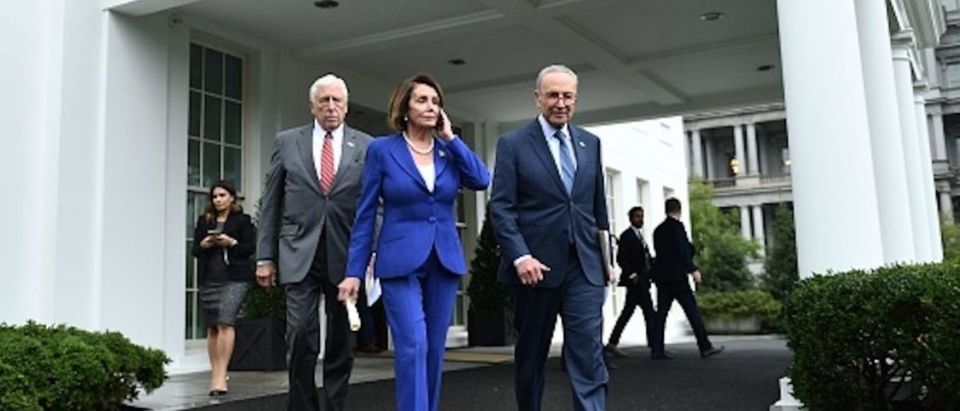 Speaker of the House Nancy Pelosi (C), Senate Minority Leader Chuck Schumer (D-NY) (R) and Representative Steny Hoyer, walk out of the White House