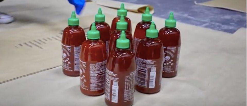 Sriracha Sauce Drug Bust (Photo: YouTube Screenshot)