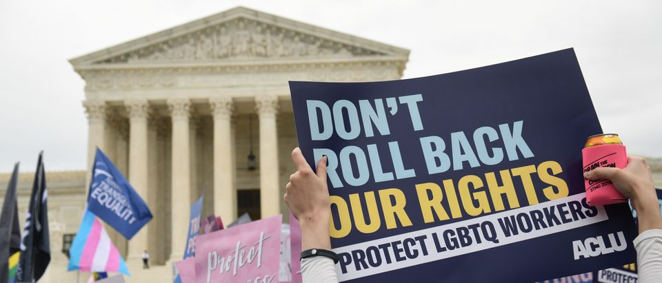 Demonstrators in favor of LGBT rights rally outside the Supreme Court on October 8, 2019. (Saul Loeb/AFP/Getty Images)