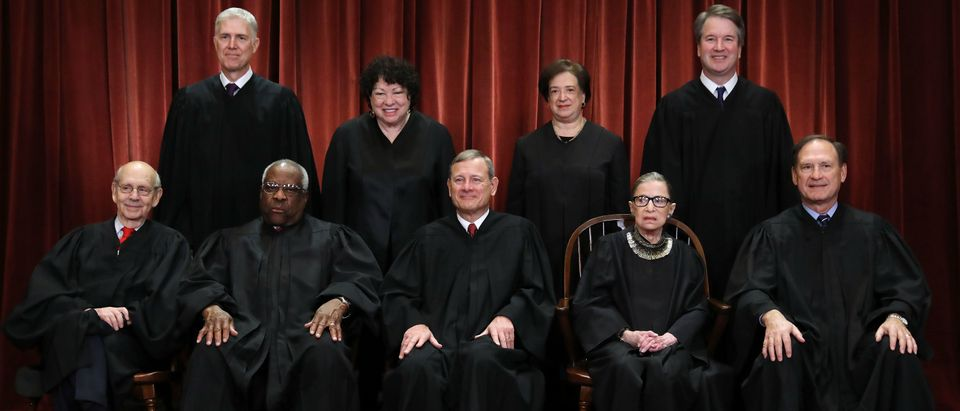 The justices of the Supreme Court sit for their official portrait on November 30, 2018. (Chip Somodevilla/Getty Images)