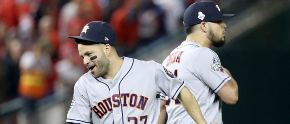 OCTOBER 25: Jose Altuve #27 and Roberto Osuna #54 of the Houston Astros of the Houston Astros celebrate their teams 4-1 win over the Washington Nationals in Game Three of the 2019 World Series at Nationals Park on October 25, 2019 in Washington, DC. (Photo by Rob Carr/Getty Images)