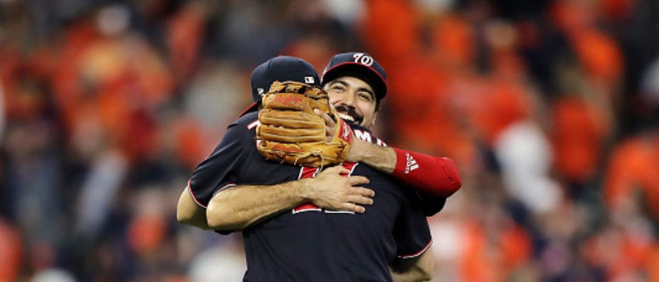 HOUSTON, TEXAS - OCTOBER 29: Anthony Rendon #6 and Ryan Zimmerman #11 of the Washington Nationals celebrate their teams 7-2 win against the Houston Astros in Game Six of the 2019 World Series at Minute Maid Park on October 29, 2019 in Houston, Texas. (Photo by Elsa/Getty Images)