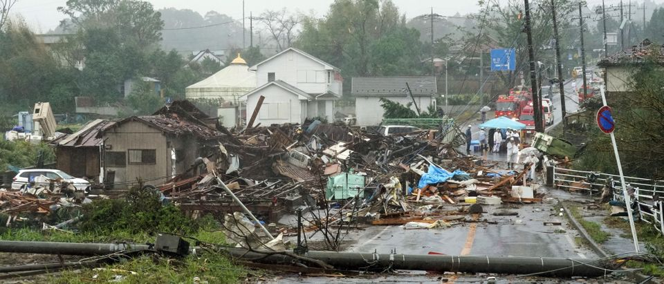 Destroyed houses, cars and power poles, which according to local media were believed to be caused by a tornado, are seen as Typhoon Hagibis approaches the Tokyo area in Ichihara, east of Tokyo, Japan, in this photo taken by Kyodo October 12, 2019. Kyodo/via REUTERS