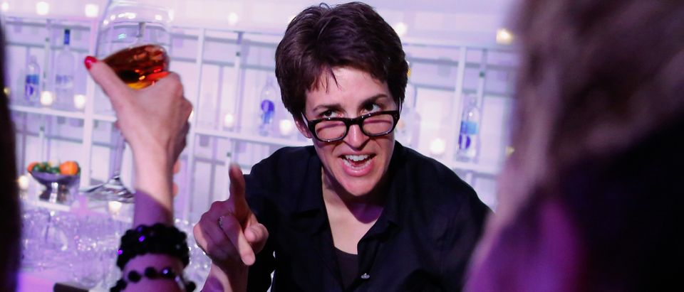 TV host Rachel Maddow tends bar at the MSNBC after-party at the Italian Embassy, following the annual White House Correspondents' Association dinner in Washington, April 27, 2013. REUTERS/Jonathan Ernst