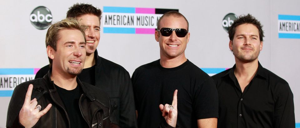 Rock band Nickelback poses on arrival at the 2011 American Music Awards in Los Angeles November 20, 2011. REUTERS/Danny Moloshok