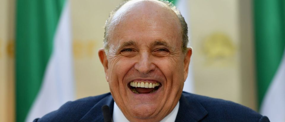 """Rudy Giuliani, Former Mayor of New York City speaks to the Organization of Iranian American Communities during their march to urge """"recognition of the Iranian people's right for regime change,"""" outside the United Nations Headquarters in New York on September 24, 2019. (ANGELA WEISS/AFP/Getty Images)"""