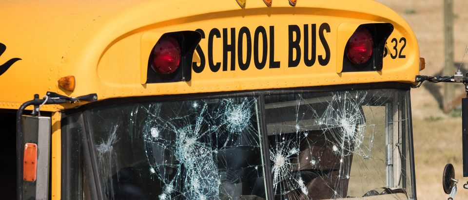 This school bus with shot-up windows is part of a training course for police dogs. Shutterstock/PuffinsPictures