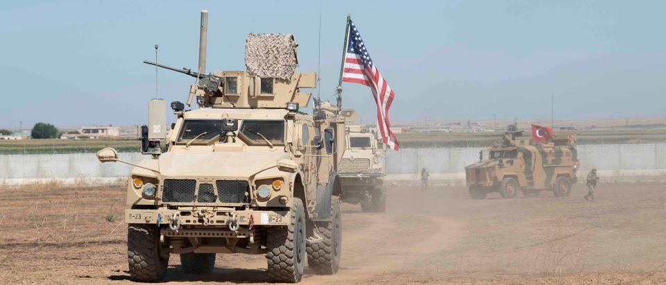 U.S. and Turkish military forces conduct a joint ground patrol inside the security mechanism area in northeast, Syria, September 8, 2019. Picture taken September 8, 2019. U.S. Army/Spc. Alec Dionne/Handout