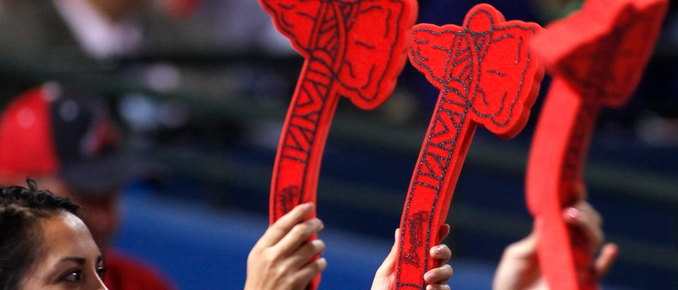 Atlanta Braves fans chop with their foam tomahawks for the Atlanta Braves at their MLB National League baseball game opener at Turner Field in Atlanta, Georgia April 1, 2013. REUTERS/Tami Chappell