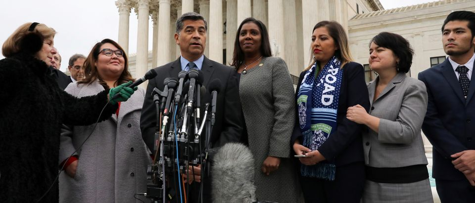 California Attorney General Becerra, flanked by New York State Attorney General James and DACA plaintiffs Rosas and Fernandez, speaks to reporters outside the U.S. Supreme Court after oral arguments in cases regarding the Trump administrationís bid to en