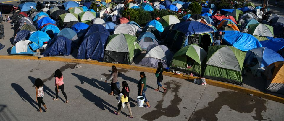 "Migrants, most of them asylum seekers sent back to Mexico from the U.S. under the ""Remain in Mexico"" program officially named Migrant Protection Protocols (MPP), occupy a makeshift encampment in Matamoros, Tamaulipas, Mexico, Oct. 28, 2019. REUTERS/Loren Elliott"