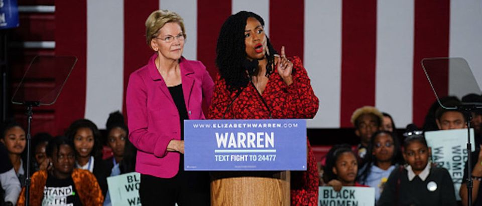 Democratic presidential candidate Sen. Elizabeth Warren (D-MA), stands with U.S. Rep. Ayanna Pressley (D-MA) as she addresses a group of protesters during a campaign event at Clark Atlanta University on November 21, 2019 in Atlanta, Georgia