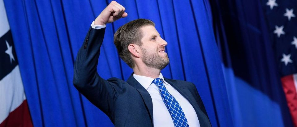 """Eric Trump, son of the US president, gestures as he arrives for a """"Keep America Great"""" rally at the Target Center in Minneapolis, Minnesota on October 10, 2019. (Photo by BRENDAN SMIALOWSKI/AFP via Getty Images)"""
