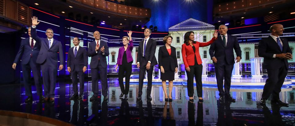 (L-R) Democratic presidential candidates New York City Mayor Bill de Blasio (L-R), Rep. Tim Ryan, former Housing Secretary Julian Castro, Sen. Cory Booker, Sen. Elizabeth Warren, former Texas Rep. Beto O'Rourke, Sen. Amy Klobuchar, Rep. Tulsi Gabbard, Washington Gov. Jay Inslee, and former Maryland Rep. John Delaney take the stage for the first Democratic presidential primary debate for the 2020 election at the Adrienne Arsht Center for the Performing Arts, June 26, 2019 in Miami, Florida. (Photo by Drew Angerer/Getty Images)